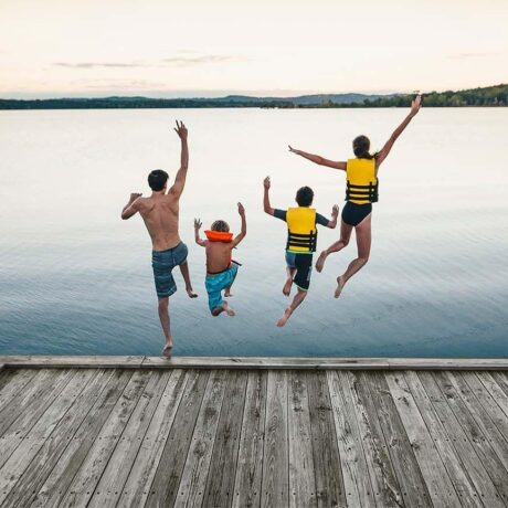 Four kids jump off a dock at Table Rock Lake.