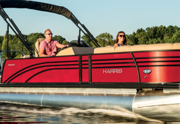 A photo of a cherry red Sunliner boat available for rent at Murray Harbor marina.