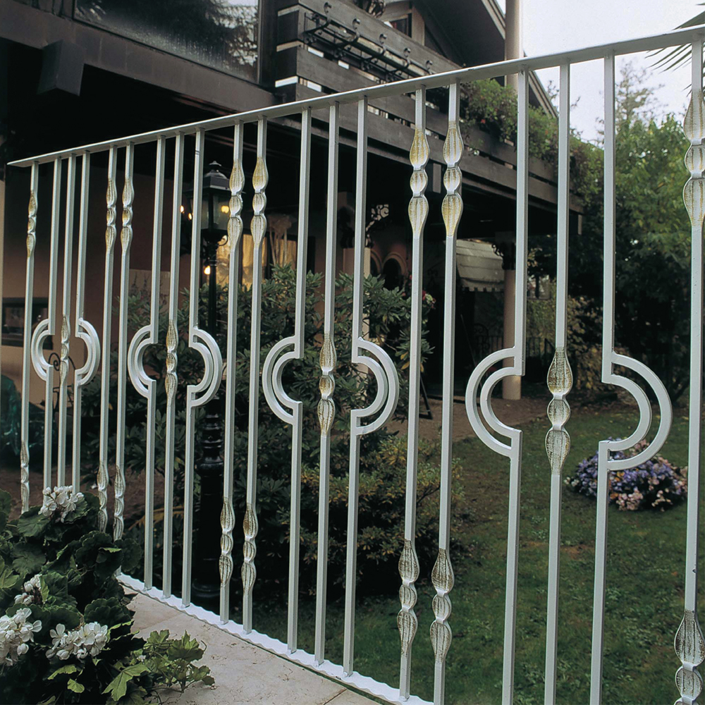 Modern looking fence with half moon balusters