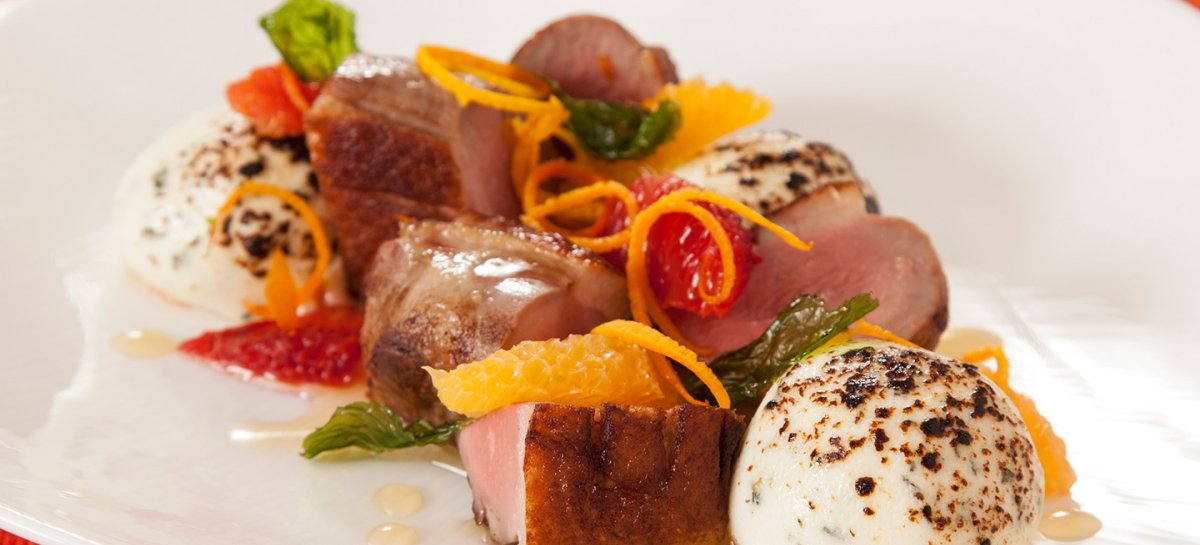 Citrus seared maple leaf farms duck breast with herb goat cheese