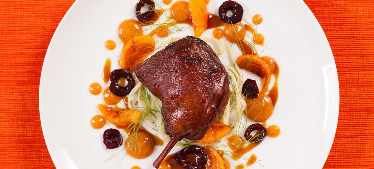 Five spice duck legs with warm pickled fennel cherries and persimmons