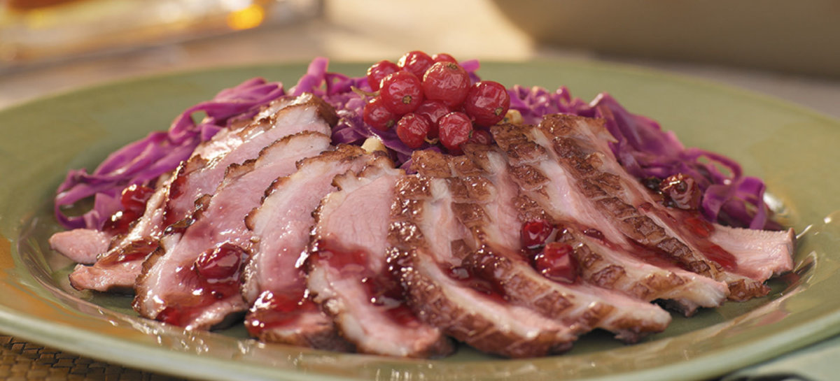 Grilled duck with currant sauce and red cabbage salad