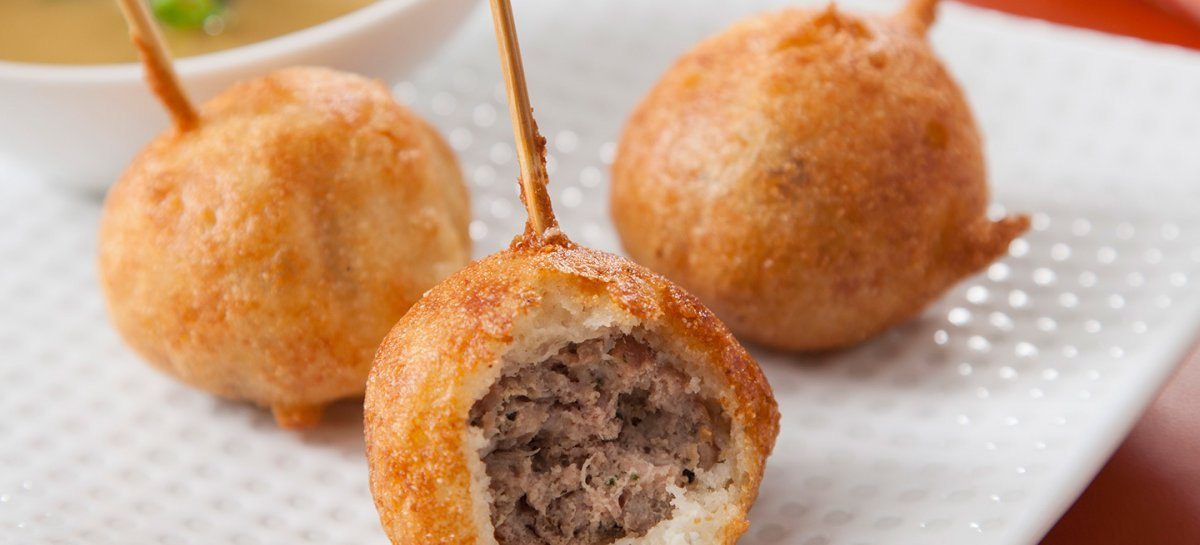 Mini duck corn dogs with maple orange mustard sauce