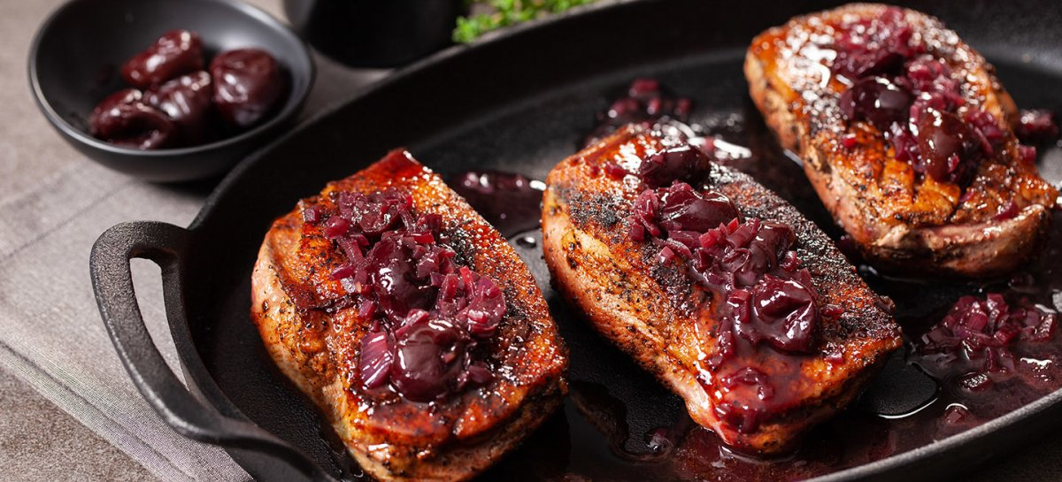 Mocha rubbed duck breast cherries and red wine pan sauce