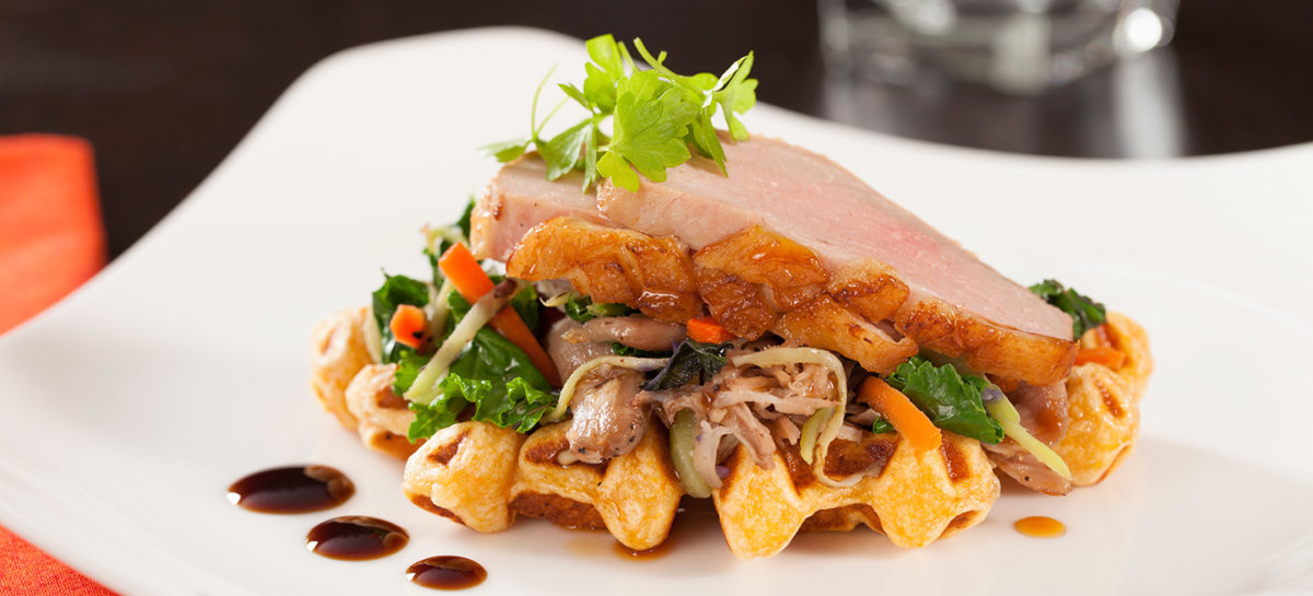 Pear and ginger tea duck breast on sweet potato waffle with duck confit slaw