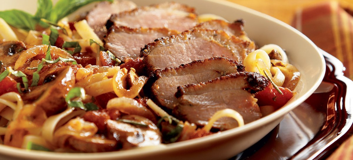 Roasted garlic duck cacciatore with balsamic glazed onions