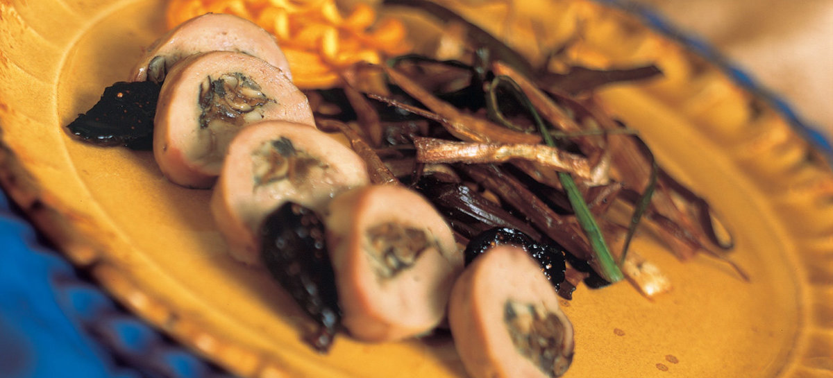 Wild mushroom stuffed smoked duck breast roulade