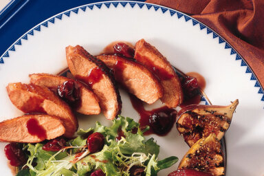 Blue cornmeal cursted duck breast with mesclun mix