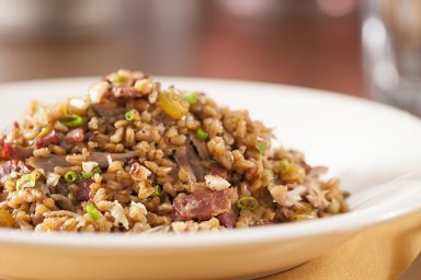 Duck and mushroom farro risotto with toasted hazelnuts