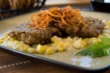Duck cakes with bourbon creamed corn