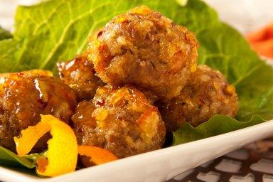 Duck meatballs in orange sauce