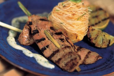 Lemongrass duck satay with grilled pineapple peanut curry noodles