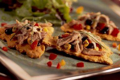 Roasted duck nacho on chili cracker