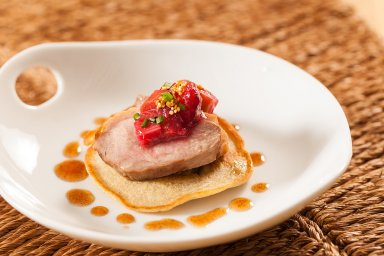 Seared duck breast blini with plum and rhubarb compote and quinoa confit