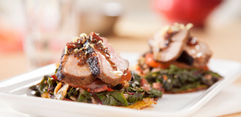Creole duck with crispy corn flakes and candied greens