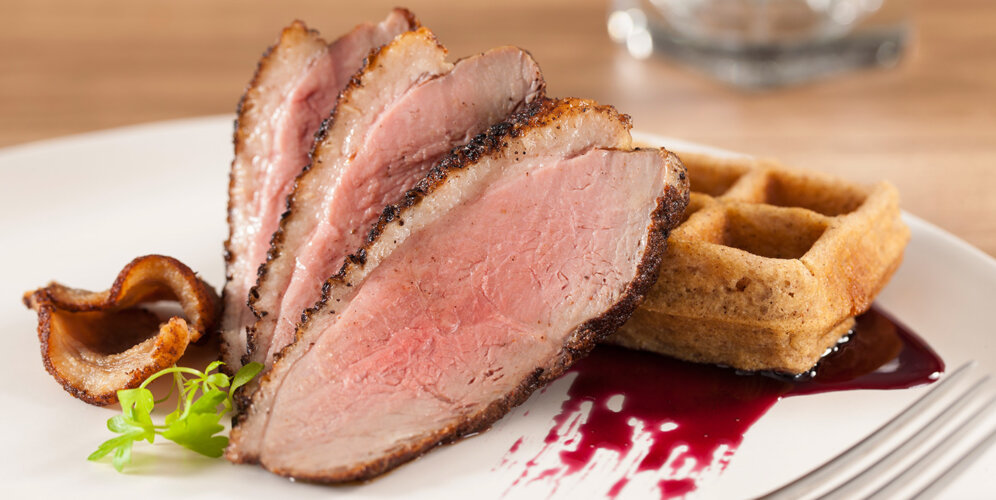 Smoked duck breast jwith five spice waffles and hibiscus syrup