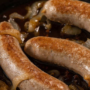 Duck bratwursts with onions