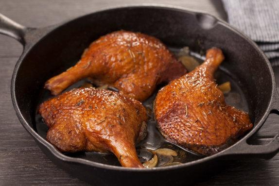 Duck confit legs in pan