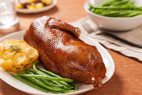 Roast half duck with green beans