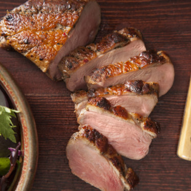 Roasted Garlic - Boneless Gourmet Flavored Duck Breast, Skin On plated