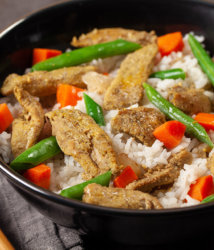 Southeast asian duck tenders in bowl