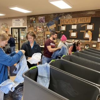 Employees of The ROP Shop and Outdoor Concepts sort and pack clothing to be shipped out by Forgotten Children Worldwide to needy around the world.