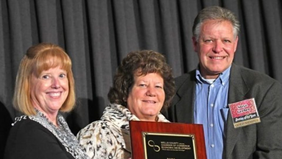 Steve and Gayla Gerber accept the award for business of the year, presented to The ROP Shop's parent company, Outdoor Concepts.