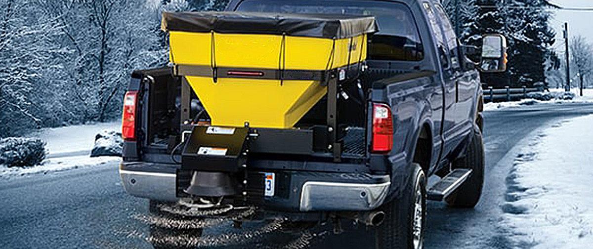 Truck usling a larger salt spreader system.