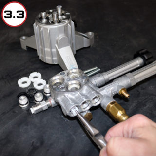 STEP 3.3 - As before, carefully remove the check valve parts (seal, housing, valve, and springs may pull free as one piece or in parts). Avoid marring the sidewalls of the head. Again, you can use one of the bolts that are used to fasten the head to the pump to wedge into the middle of the seal and remove it.