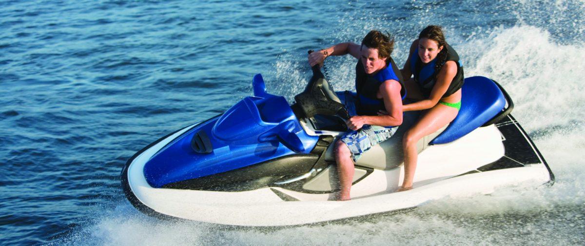 A couple enjoy their jet ski.