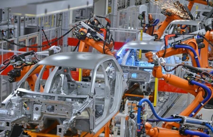 Robots assembling passenger cars on an assembly line