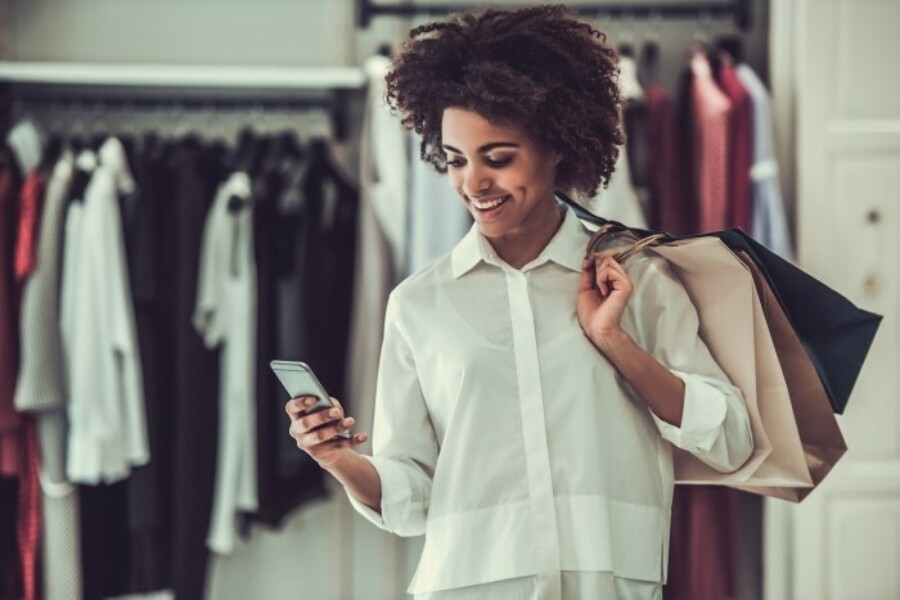 woman holding phone in retail store