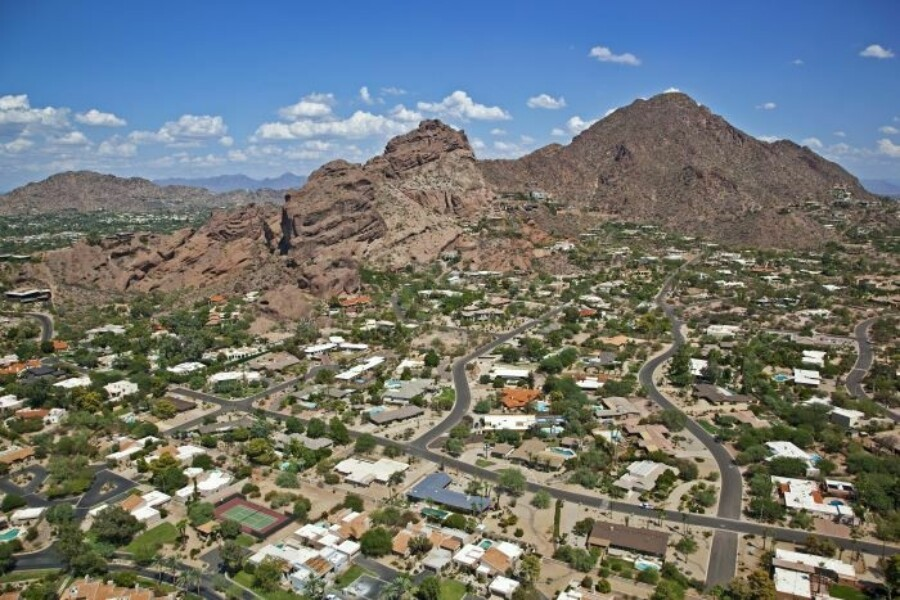 Camelback Mountain in Phoenix surrounded by desert homes and resorts