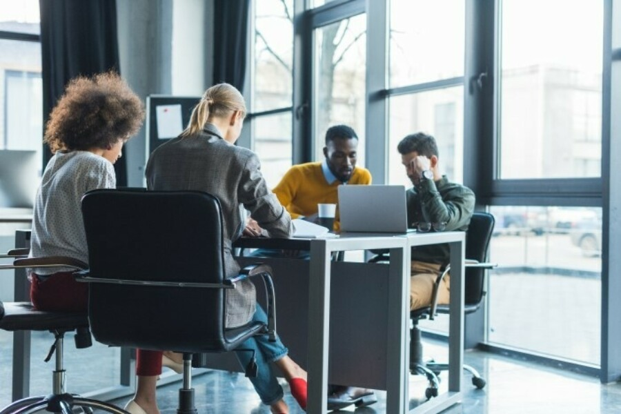 diverse group of employees working in office