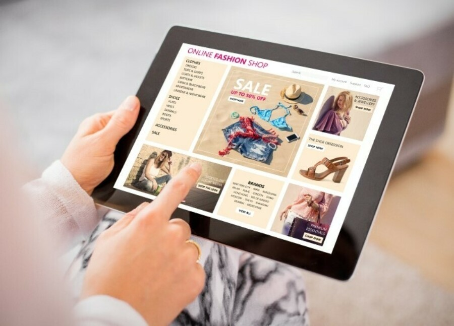 A woman shopping online using a tablet.