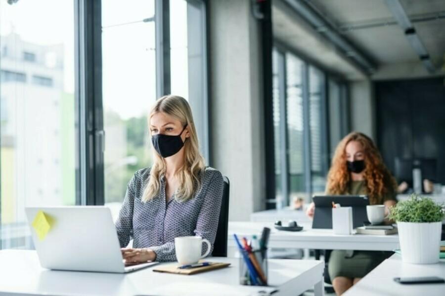 office workers practice social distancing