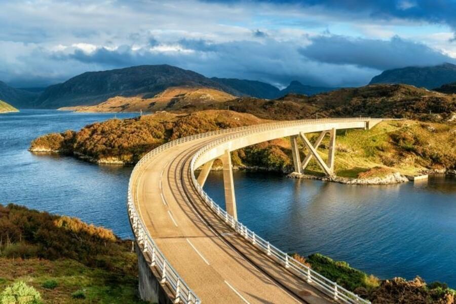 FF bridge across river mountains 700x467