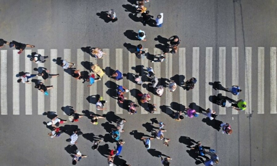 Overhead shot of a group of people crossing the street.