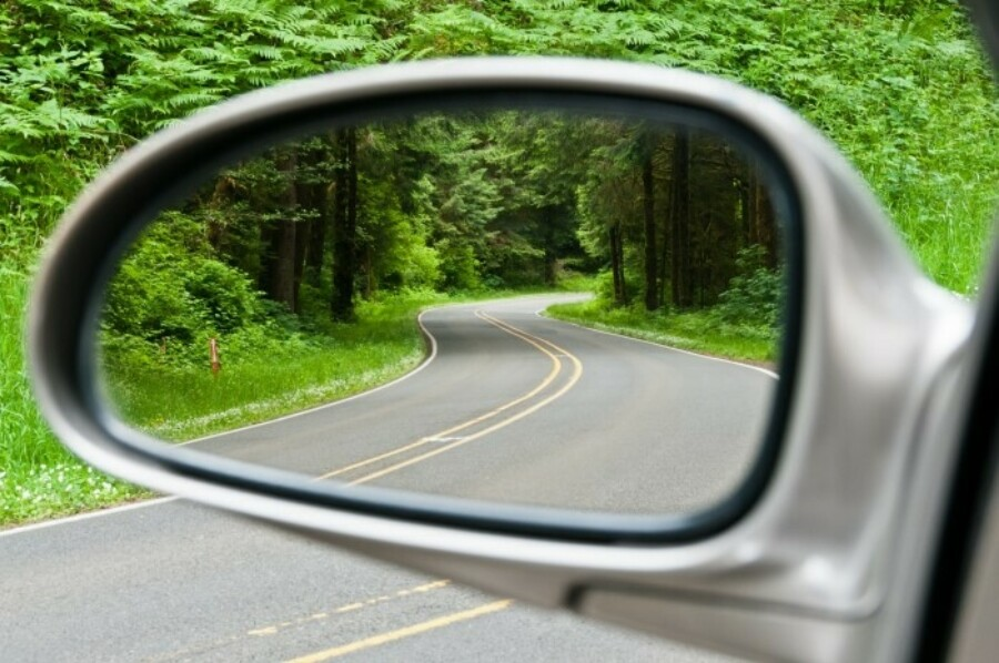 Looking through side mirror on car