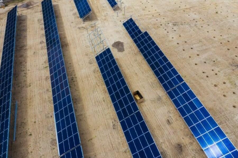 solar panels on a solar farm under construction