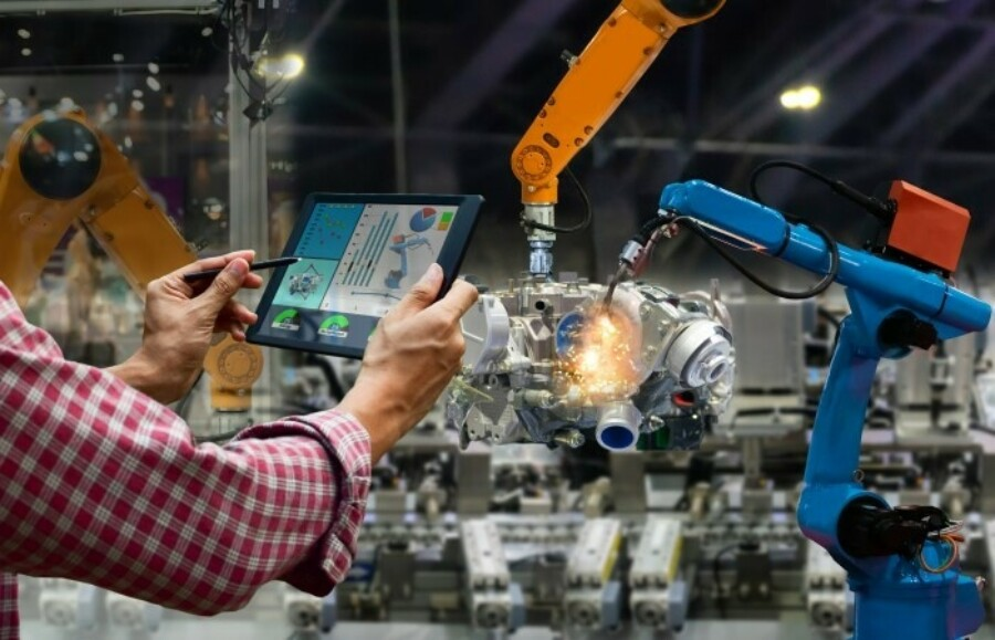 Tablet being used in a production plant with robot welders