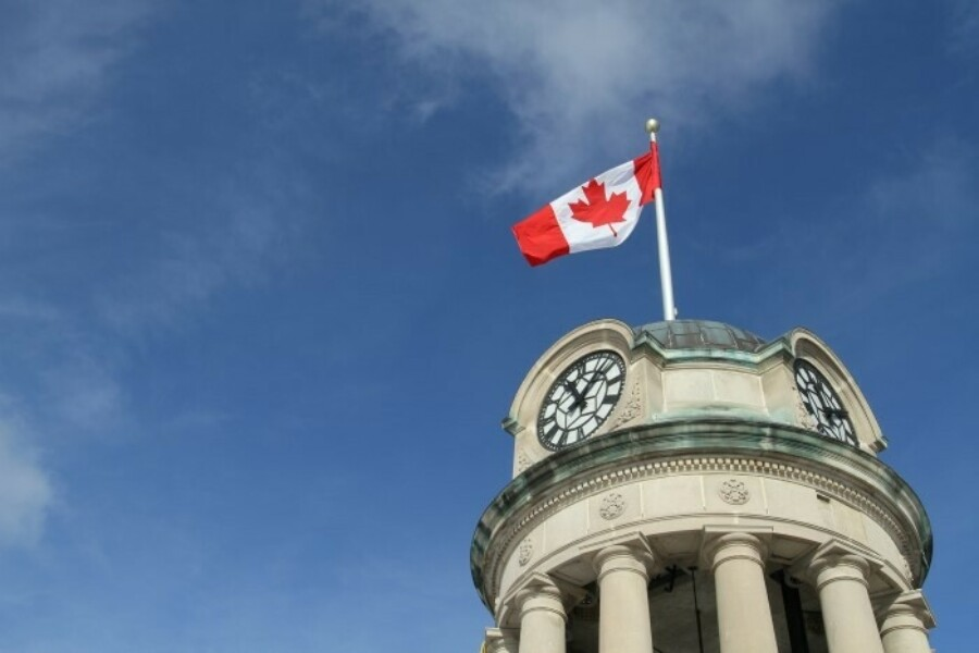 Canadian flag on top of clock tower