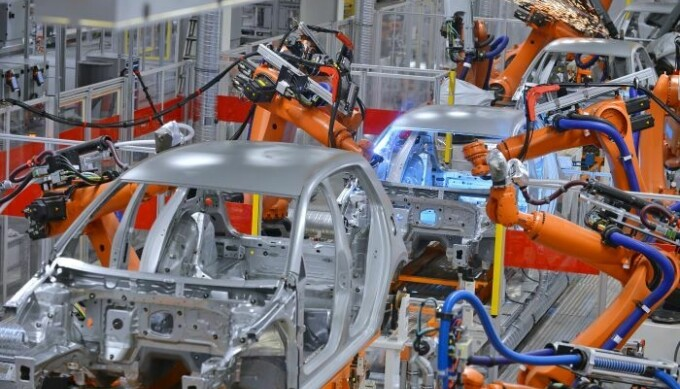 Robots assembling passenger cars on an assembly line