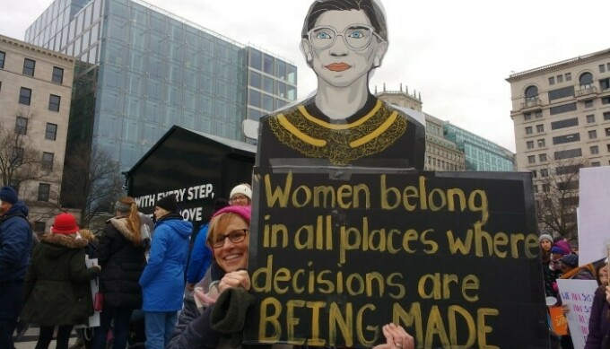 Woman holding up Ruth Bader Ginsburg sign at rally