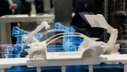 Digital twin replica of an automobile on the assembly line