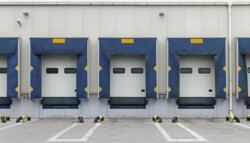 Outside of a distribution center with doors for tractor trailers