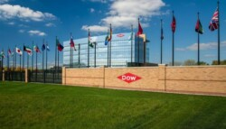 flags of many nations flying outside Dow corporate headquarters