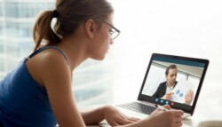 woman interacts with coworker on video conference