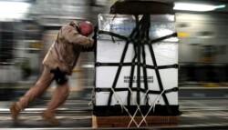man pushing large cargo package