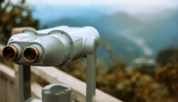 set of binoculars looking out to the mountains